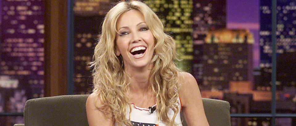 """Heather Locklear on """"The Tonight Show with Jay Leno"""" at the NBC Studios in Los Angeles, October 15, 2001. (Photo by Kevin Winter/Getty Images)"""
