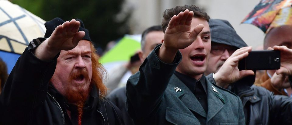 Far-right militants make the fascist salute (Roman salute) during a rally to celebrate the life and the death of Italian dictator Benito Mussolini in Predappio, on April 24, 2016. The rally is organized in Predappio, where Mussolini was born and is buried. / AFP / TIZIANA FABI (Photo credit should read TIZIANA FABI/AFP/Getty Images)