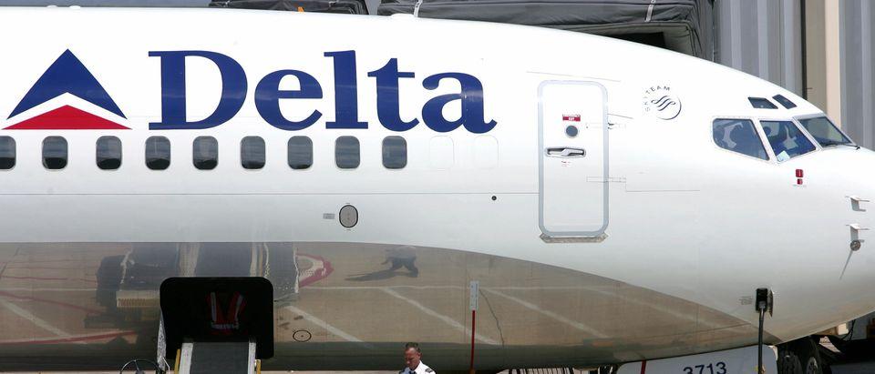 A pilot for Delta Airlines checks his wa