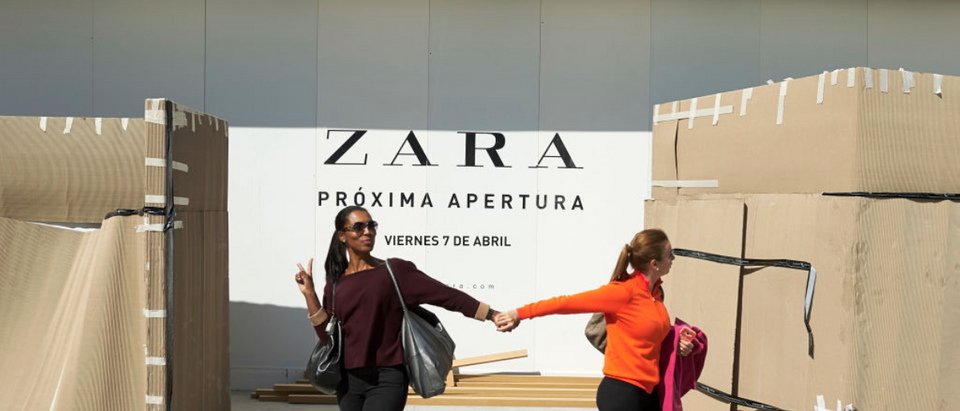 MADRID, SPAIN - MARCH 29: Two woman walk past the front of Zara store on March 29, 2017 in Madrid Spain. This store will be the biggest Zara store of the world at 6,000 square meters and will be opening on April 7. (Photo by Carlos Alvarez/Getty Images)