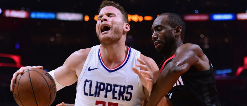 LOS ANGELES, CA - JANUARY 15: Blake Griffin #32 of the LA Clippers reacts as he posts up Luc Mbah a Moute #12 of the Houston Rockets during a 113-102 Clipper win at Staples Center on January 15, 2018 in Los Angeles, California. (Photo by Harry How/Getty Images)