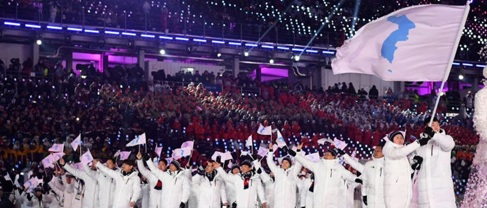 The North Korea and South Korea Olympic teams enter together under the Korean Unification Flag during the Parade of Athletes during the Opening Ceremony of the PyeongChang 2018 Winter Olympic Games at PyeongChang Olympic Stadium on February 9, 2018 in Pyeongchang-gun, South Korea. (Photo by Matthias Hangst/Getty Images)