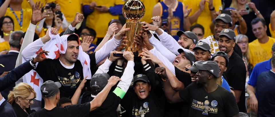 Golden State Warriors players and coaches celebrate with the Larry O'Brien Trophy after defeating the Cleveland Cavaliers in game five of the 2017 NBA Finals at Oracle Arena, June 12, 2017. Kyle Terada-USA TODAY Sports