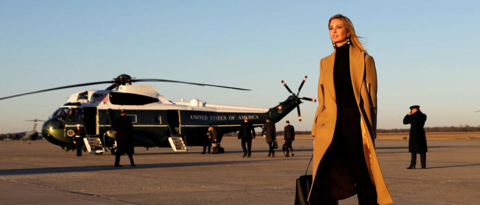 Ivanka Trump walks from Air Force One to a waiting vehicle upon arrival, as U.S. President Donald Trump boards Marine One in the background, at Joint Base Andrews in Maryland