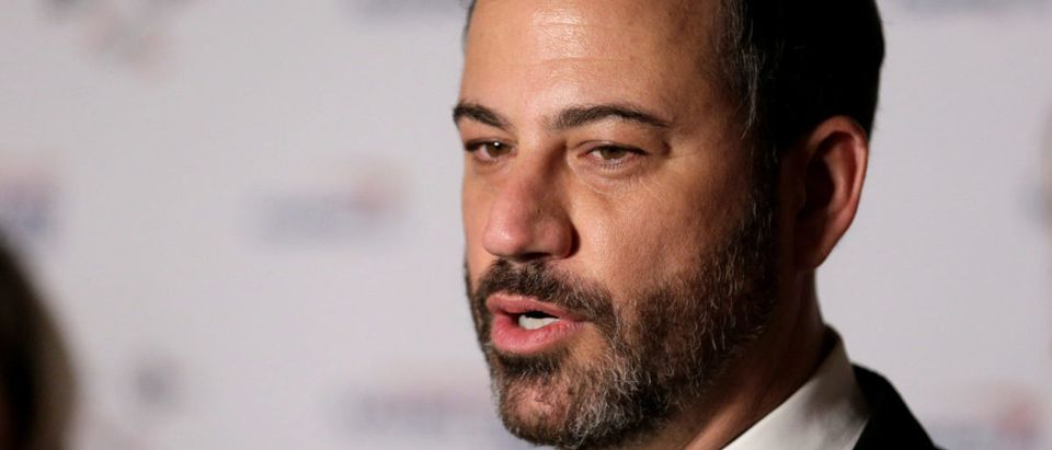 Comedian Jimmy Kimmel speaks to the media at a gala honoring David Letterman, who is receiving the Mark Twain Prize for American Humor at Kennedy Center, in Washington