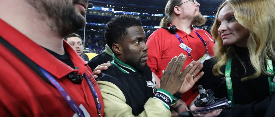 MINNEAPOLIS, MN - FEBRUARY 04: Comedian and Philidelphia native Kevin Hart attempts to get onto the stage following the Eagles 41-33 win over the New England Patriots in Super Bowl LII at U.S. Bank Stadium on February 4, 2018 in Minneapolis, Minnesota. (Photo by Elsa/Getty Images)