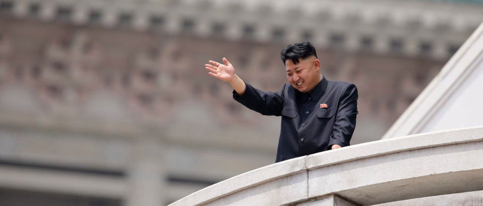 North Korean leader Kim Jong-un waves to the people during a parade in Pyongyang