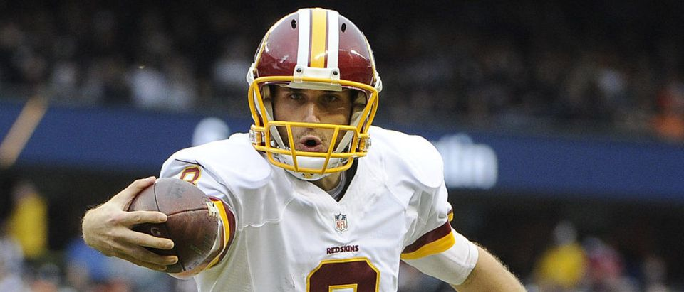 Kirk Cousins #8 of the Washington Redskins scores a touchdown during the first quarter against the Chicago Bears on December 13, 2015 at Soldier Field in Chicago. (Photo by David Banks/Getty Images)