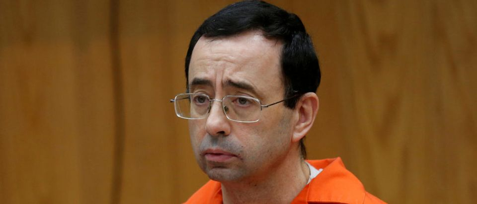 FILE PHOTO: Larry Nassar a former team USA Gymnastics doctor who pleaded guilty to sexual assault listens to victims impact statements during his sentencing in the Eaton County Circuit Court in Charlotte