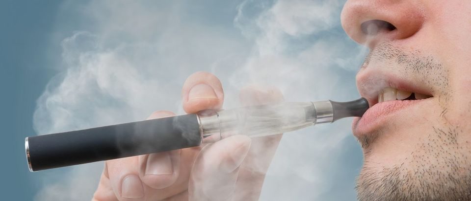 Man is smoking e-cigarette. (vchal/Shutterstock)