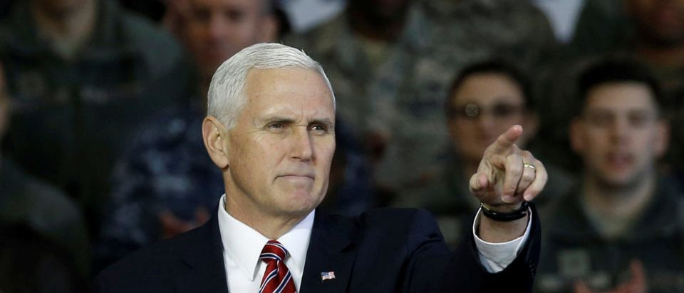U.S. Vice President Mike Pence gestures after addressing U.S. military members and Japan's Self-Defense Force (JSDF) before he departs for South Korea, at Yokota U.S. Air Force Base in Fussa, on the outskirts of Tokyo, Japan, February 8, 2018. REUTERS/Toru Hanai