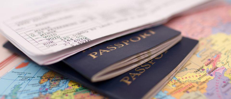 Passports on top of a world map. (Shutterstock)