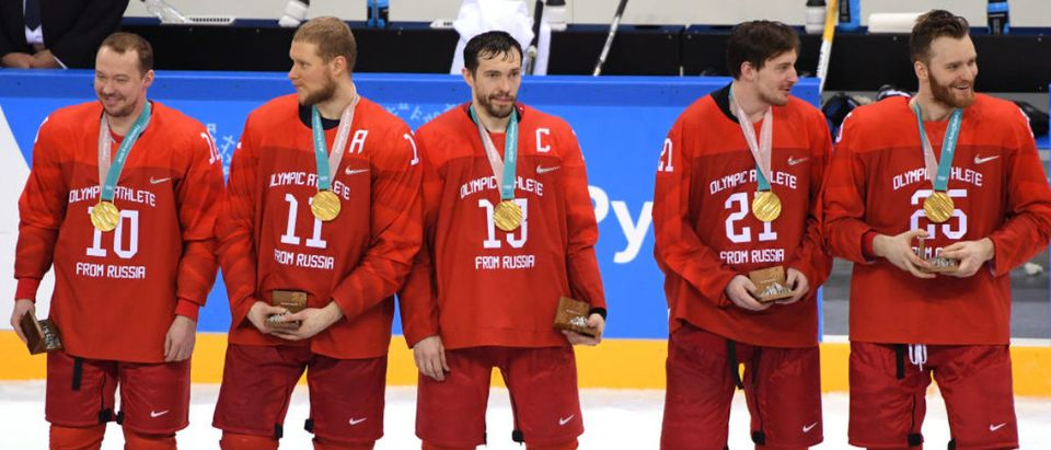 GANGNEUNG, SOUTH KOREA - FEBRUARY 25: Gold medal winners Olympic Athletes from Russia celebrate during the medal ceremony after defeating Germany 4-3 in overtime during the Men's Gold Medal Game on day sixteen of the PyeongChang 2018 Winter Olympic Games at Gangneung Hockey Centre on February 25, 2018 in Gangneung, South Korea. (Photo by Harry How/Getty Images)