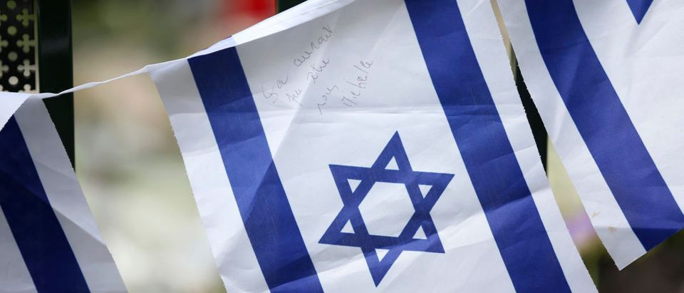"""An Israeli flag with the words """"It could have been us"""" hangs outside the Jewish Museum in Brussels May 27, 2014. Belgian police on Sunday were hunting a gunman who shot dead two Israelis and a French woman at the Jewish Museum in Brussels, in an attack French President Francois Hollande said was without doubt motivated by anti-Semitism. REUTERS/Francois Lenoir"""