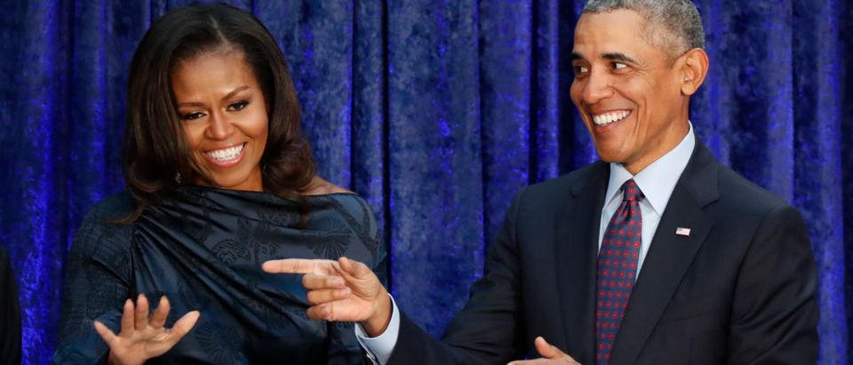 Former U.S. President Obama and first lady Michelle Obama acknowledge guests during portraits unveiling at the Smithsonians National Portrait Gallery in Washington