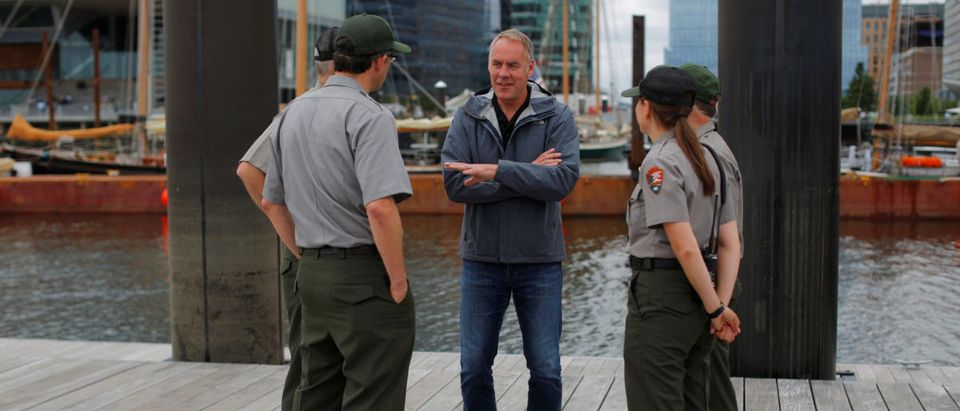 U.S. Interior Secretary Ryan Zinke (C) talks to National Park Service Rangers, while traveling for his National Monuments Review process, in Boston, Massachusetts, U.S., June 16, 2017. Picture taken June 16, 2017. REUTERS/Brian Snyder