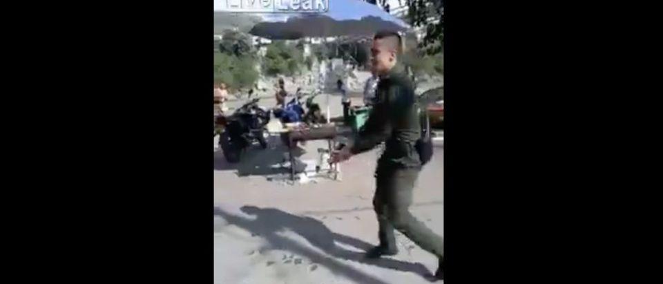 Screen Shot Colombian Cop Shoots Down Man