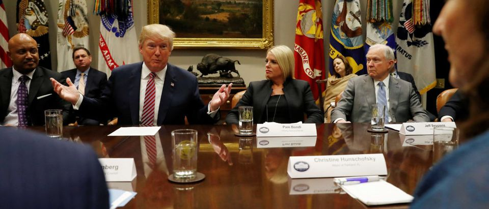 Trump meets with local and state officials about improving school safety at the White House in Washington