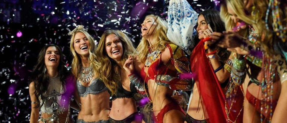 Models celebrate during the 2017 Victoria's Secret Fashion Show in Shanghai on November 20, 2017. (Photo credit: FRED DUFOUR/AFP/Getty Images)