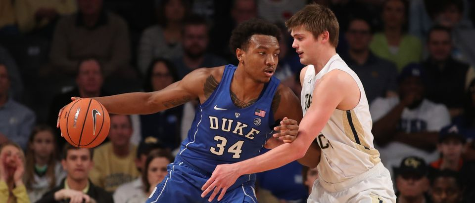 Duke Blue Devils forward Wendell Carter Jr (34) makes a move against Georgia Tech Yellow Jackets center Ben Lammers (44) during the first half at McCamish Pavilion in Atlanta, Feb. 11, 2018. Jason Getz-USA TODAY Sports