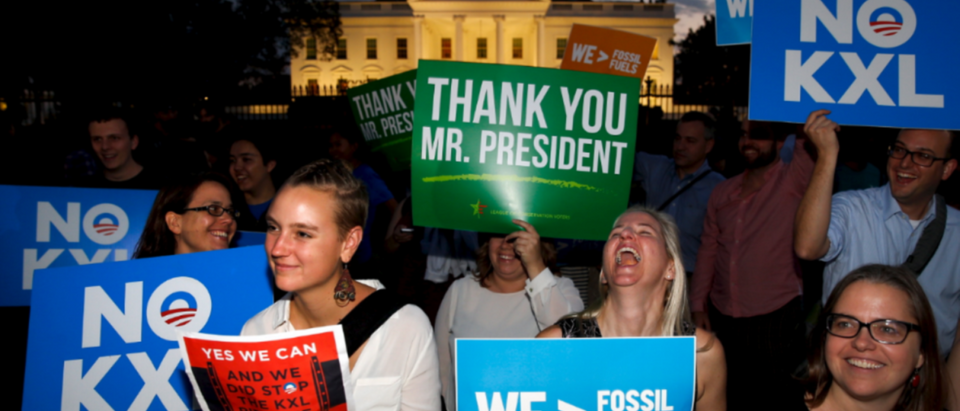 A small group of activists gather to celebrate the Obama administration's rejection of the Keystone XL pipeline, outside the White House in Washington November 6, 2015. U.S. President Barack Obama on Friday rejected the proposed Keystone XL oil pipeline from Canada in a victory for environmentalists who campaigned against the project for more than seven years. | Trump's DAPL Move Is Paying Off