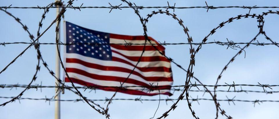 flag barbed wire Shutterstock/Savvapanf Photo