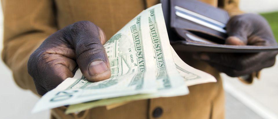 Handing Over Money Shutterstock