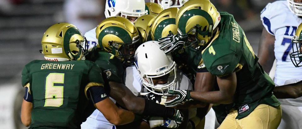 IMG Academy runner Jamal Curry-Elliot (9) is gang tackled by the Grayson Rams during the second half in a high school football duel of top ranked teams at Grayson Community Stadium. IMG Academy defeated the Grayson Rams 26-7. (Dale Zanine-USA TODAY Sports)