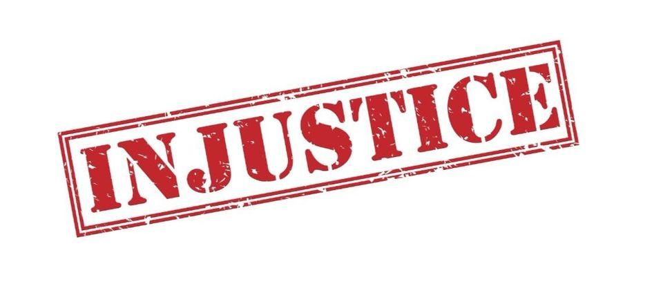 injustice Shutterstock/Tomasz Guzowski