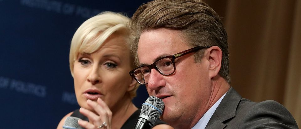 WASHINGTON, DC - JULY 12: MSNBC 'Morning Joe' hosts Joe Scarborough (R) and Mika Brzezinski are interviewed by philanthropist and financier David Rubenstein during a Harvard Kennedy School Institute of Politics event in the McGowan Theater at the National Archives July 12, 2017 in Washington, DC. Scarborough and Brzezinski, who are engaged to be married, were recently attacked by President Donald Trump on Twitter, where he called the hosts 'Psycho Joe' and 'low I.Q. Crazy Mika,' among other personal insults. (Photo by Chip Somodevilla/Getty Images)