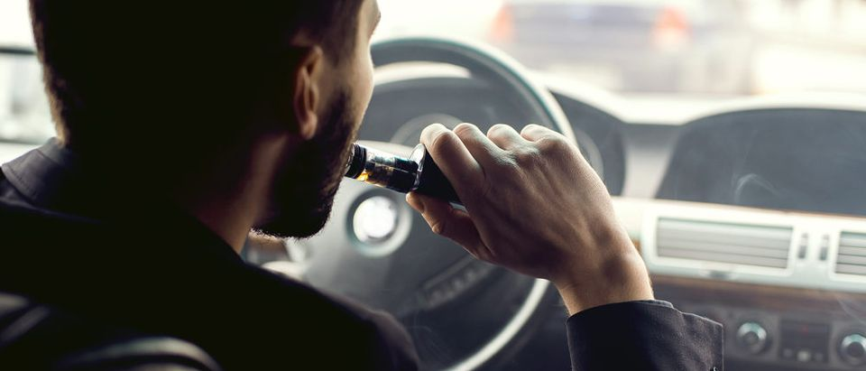 Vaping and driving (Photo via Shutterstock)