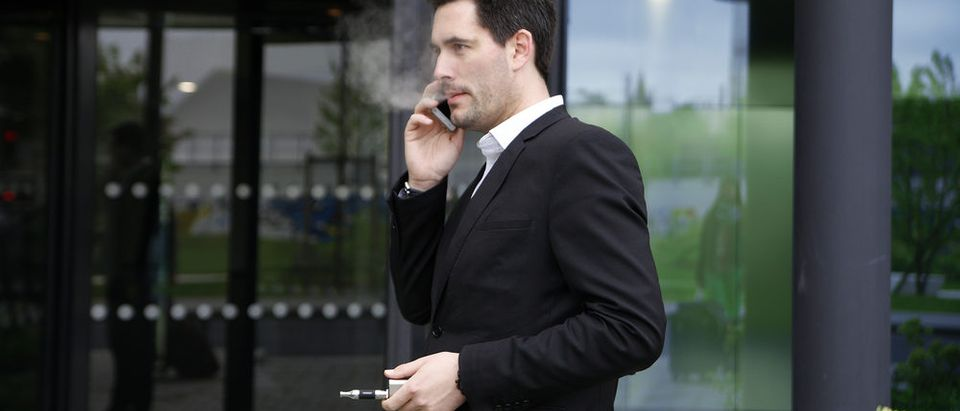 Vaping businessman (Photo via Shutterstock)