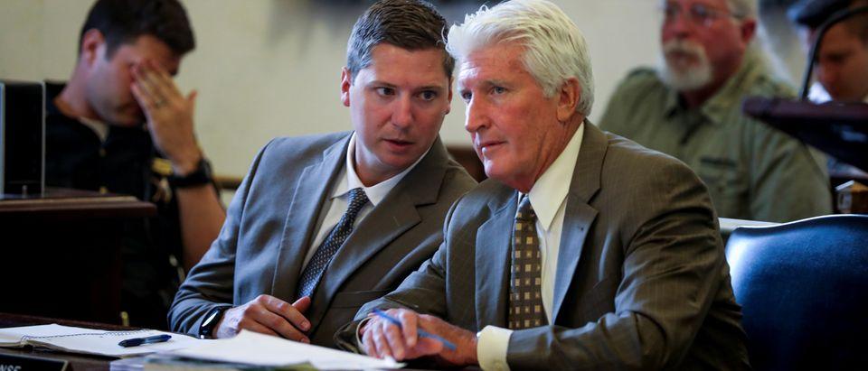 Former University of Cincinnati police officer Raymond Tensing speaks with his lawyer during his retrial in Cincinnati
