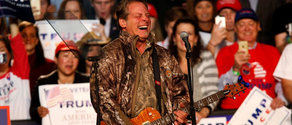 Musician and political activist Ted Nugent performs for the audience during a campaign rally for U.S. Republican presidential nominee Donald Trump at the Devos Place in Grand Rapids, Michigan