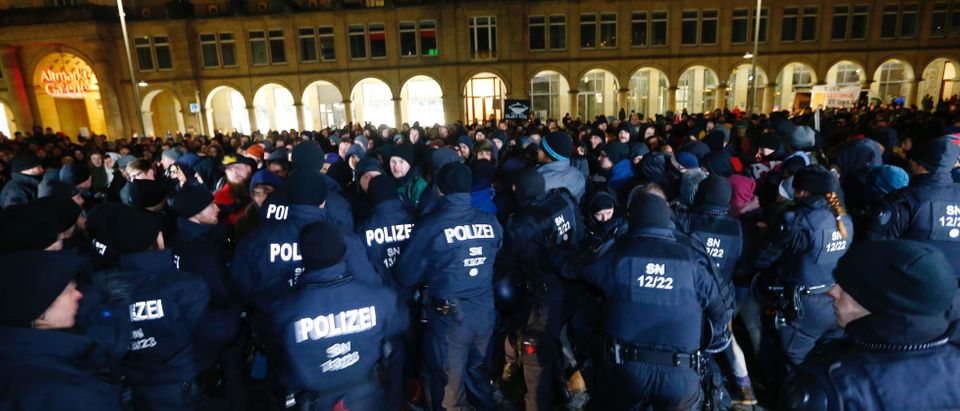 German police blocks protesters during the protest against the anti-immigrant Alternative for Germany party (AfD) vigil in Dresden
