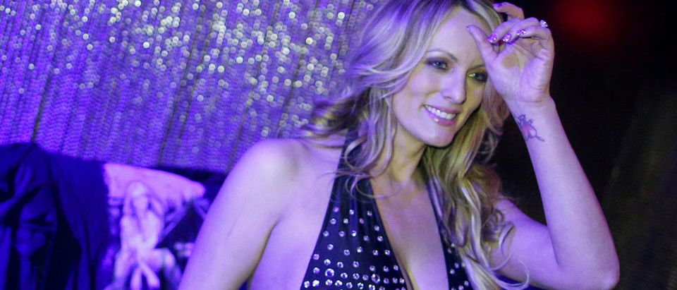 Adult-film actress Stephanie Clifford, also known as Stormy Daniels, poses for pictures at the end of her striptease show in Gossip Gentleman club in Long Island, New York, U.S., February 23, 2018. REUTERS/Eduardo Munoz