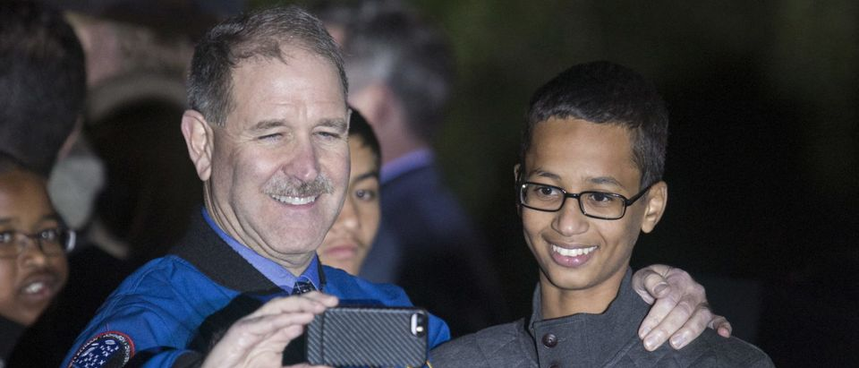 John M. Grunsfeld (L), Associate Administrator for the Science Mission Directorate, poses for a selfie with Ahmed Mohamed, 14, the Texas teenager who was arrested after bringing a homemade electronic clock to school, during the second White House Astronomy Night on the South Lawn of the White House in Washington October 19, 2015. REUTERS/Joshua Roberts
