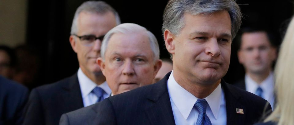 FBI Director Christopher Wray arrives for his installation ceremonies followed by U.S. Attorney General Jeff Sessions and Acting FBI Director Andrew McCabe at FBI headquarters in Washington, U.S., September 28, 2017. REUTERS/Carlos Barria | Wray Doubling Agents On Clinton Trump