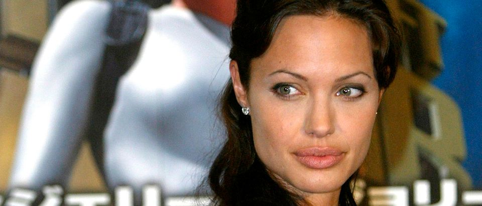 ACTRESS ANGELINA JOLIE ARRIVES FOR PREMIERE OF 'LARA CROFT AND THECRADLE OF LIFE - TOMB RAIDER 2' IN ...