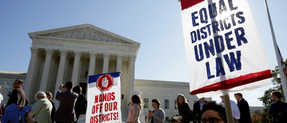 Demonstrators rally during oral arguments in Gill v. Whitford, a case about partisan gerrymandering in electoral districts, at the Supreme Court in Washington