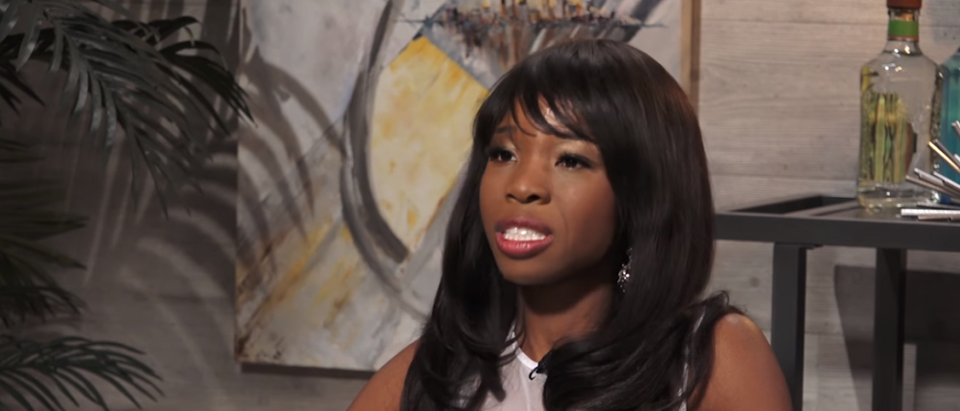 Antonia Okafor discusses abortion, guns, and conservatism with talk show host Dave Rubin. (Photo Credit: YouTube/The Rubin Report) | Flier With Gun-Toting Woman Rejected