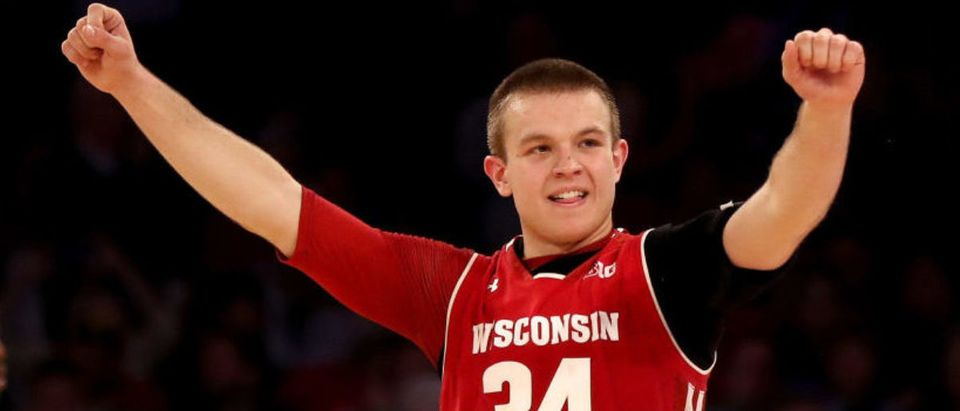 NEW YORK, NY - MARCH 01: Brad Davison #34 of the Wisconsin Badgers celebrates the win over the Maryland Terrapins during the second round of the Big Ten Basketball Tournament at Madison Square Garden on March 1, 2018 in New York City. (Photo by Elsa/Getty Images)n