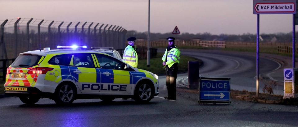British police stand guard at the entrance to the US Air Force base at RAF Mildenhall, Suffolk