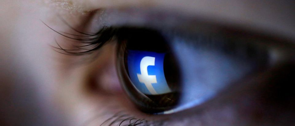 FILE PHOTO: A picture illustration shows a Facebook logo reflected in a person's eye, in Zenica