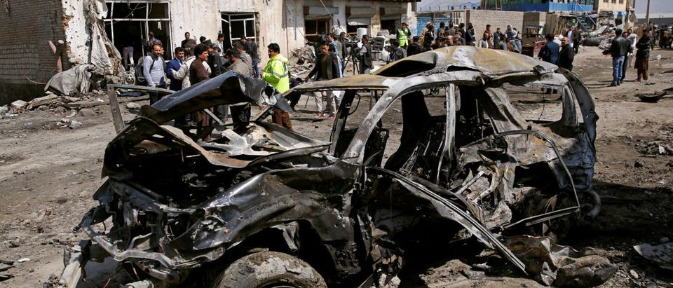 A damaged vehicle is seen after a blast in Kabul