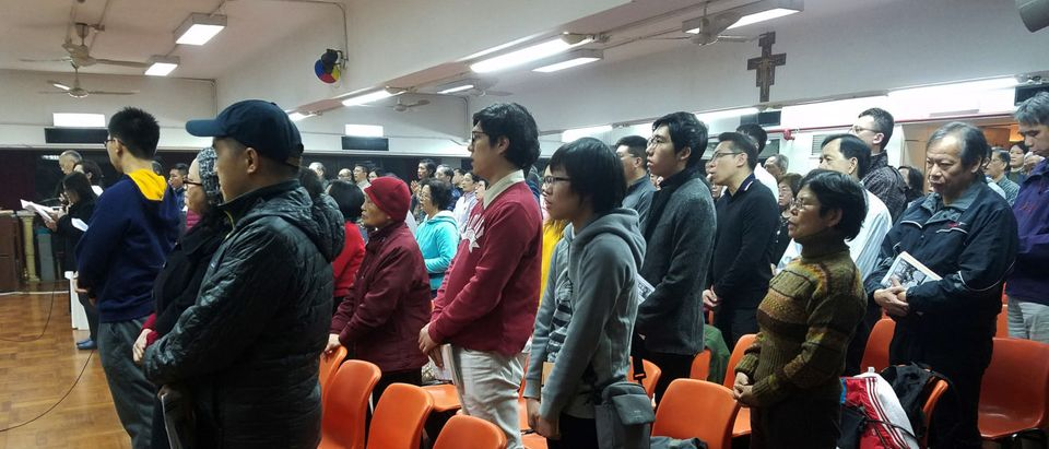 About 200 Catholics attend a prayer meeting for the Chinese Church after news emerge that Beijing and the Vatican have reached a deal on bishop appointments, in Hong Kong, China February 12, 2018. REUTERS/Venus Wu