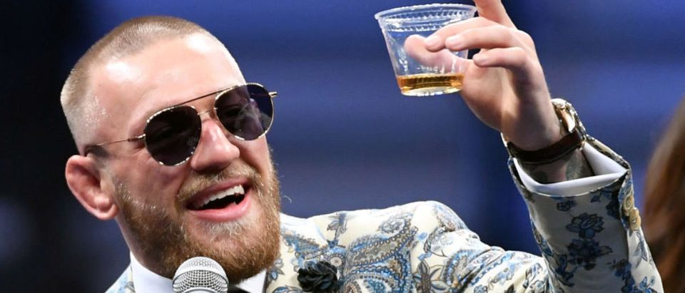 Conor McGregor holds up a cup of his Notorious-branded Irish whiskey as he speaks during a news conference following his 10th-round TKO loss to Floyd Mayweather Jr. in their super welterweight boxing match at T-Mobile Arena on August 26, 2017 in Las Vegas. (Photo by Ethan Miller/Getty Images)