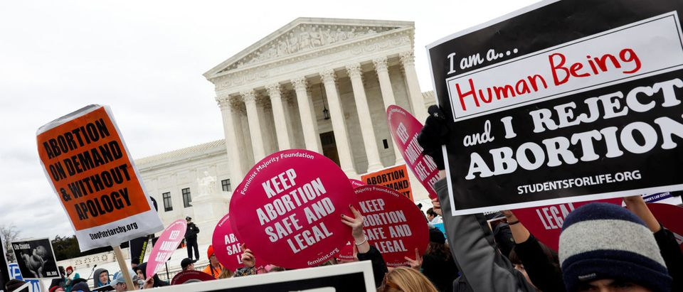 Pro-life and pro-choice activists gather at the Supreme Court for the National March for Life rally in Washington