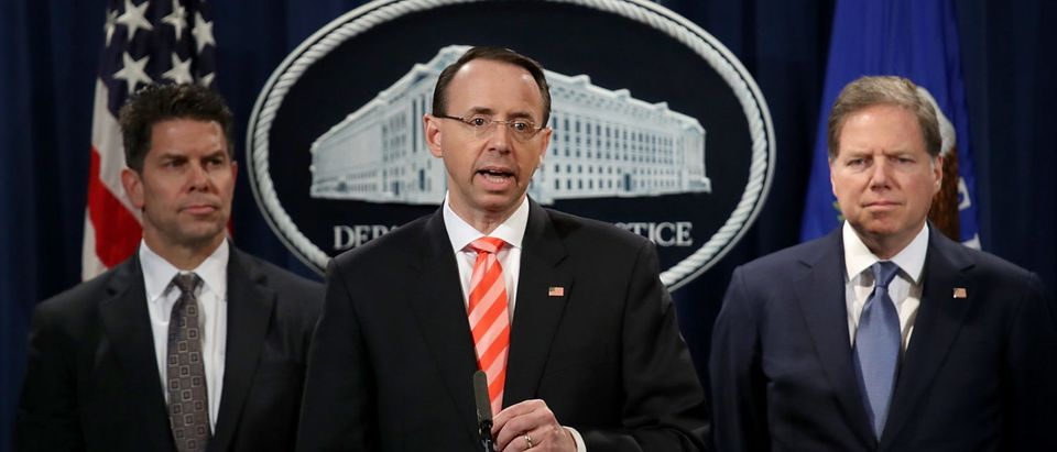 WASHINGTON, DC - MARCH 23: U.S. Deputy Attorney General Rod Rosenstein speaks at a press conference at the Department of Justice March 23, 2018 in Washington, DC. Rosenstein and other law enforcement officials announced a major cyber law enforcement action against nine Iranians charged with conducting massive cyber theft campaigns on behalf of the Islamic Revolutionary Guard Corps. (Photo by Win McNamee/Getty Images)