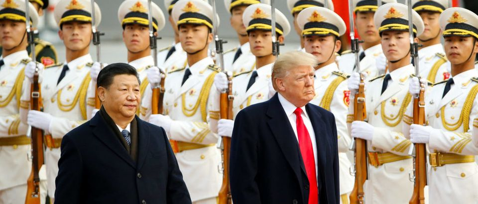 U.S. President Donald Trump takes part in a welcoming ceremony with China's President Xi Jinping in Beijing